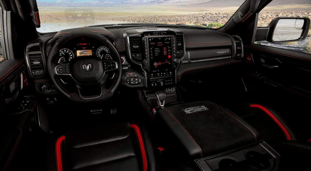 The black and red interior or a 2021 Ram 1500 TRX is shown.
