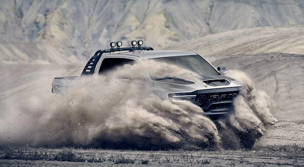 The newest Ram truck, a 2021 Ram 1500 TRX, is kicking up sand while off-roading.
