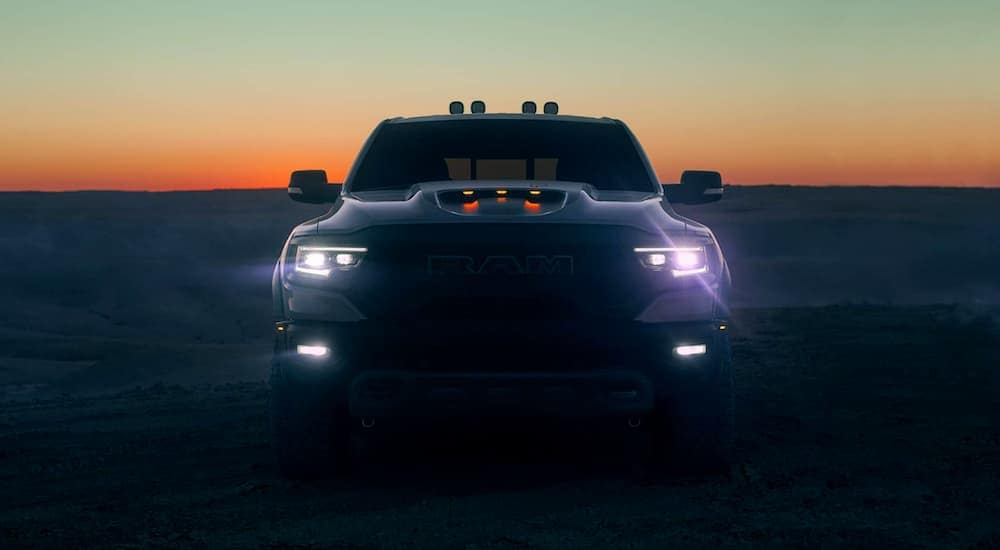 A 2021 Ram 1500 TRX is shown from the front at sunset near Lexington, KY.