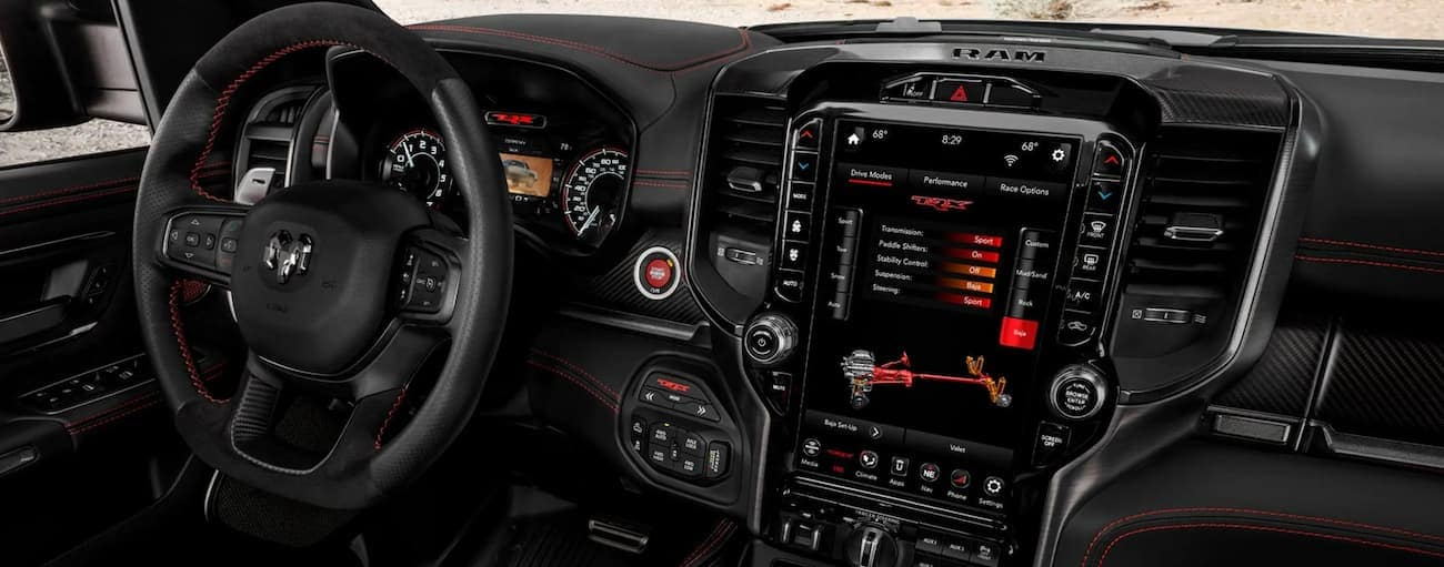 The technology features on the dashboard are shown in a 2021 Ram 1500 TRX.
