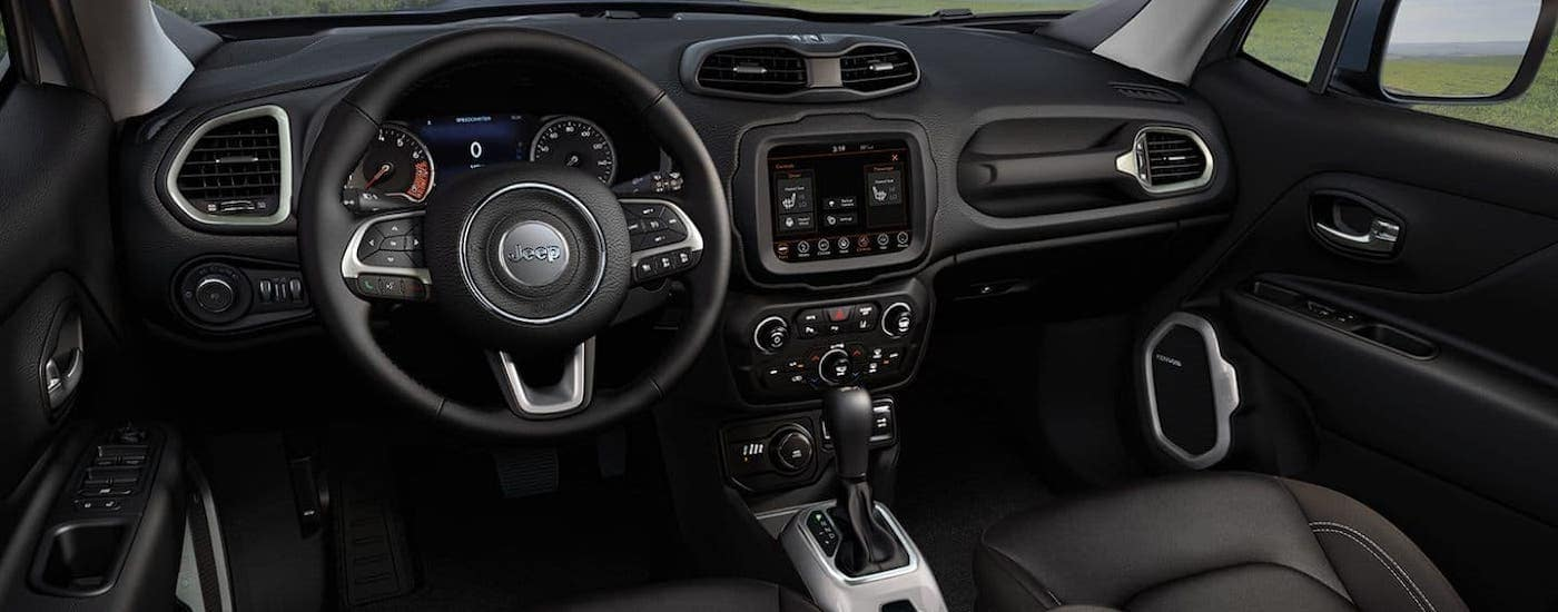 The black interior of a 2021 Jeep Renegade is shown.