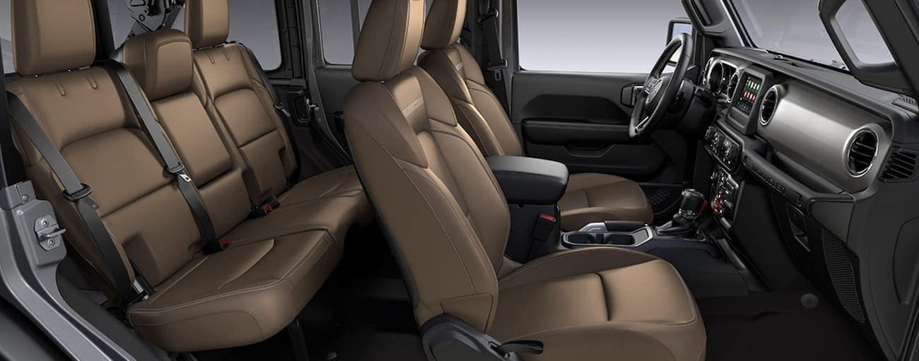 The tan interior of a 2021 Jeep Wrangler Unlimited is shown from the side.