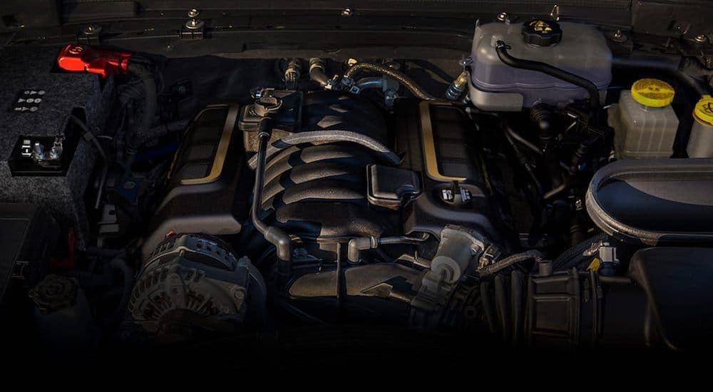 A close up is shown of the 2021 Jeep Wrangler Rubicon engine.