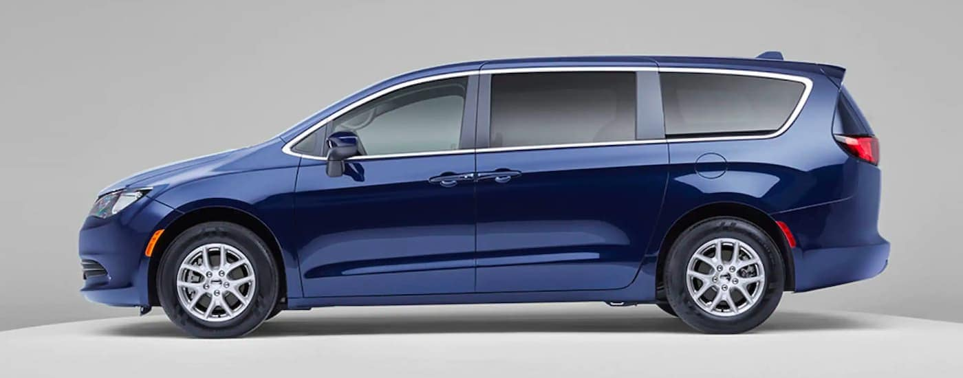 A blue 2021 Chrysler Voyager is shown from the side against a grey background.