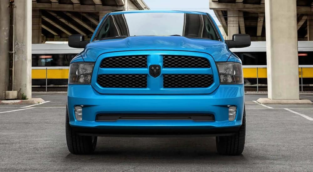 A blue 2020 Ram 1500 Classic is shown from the front in a parking garage.