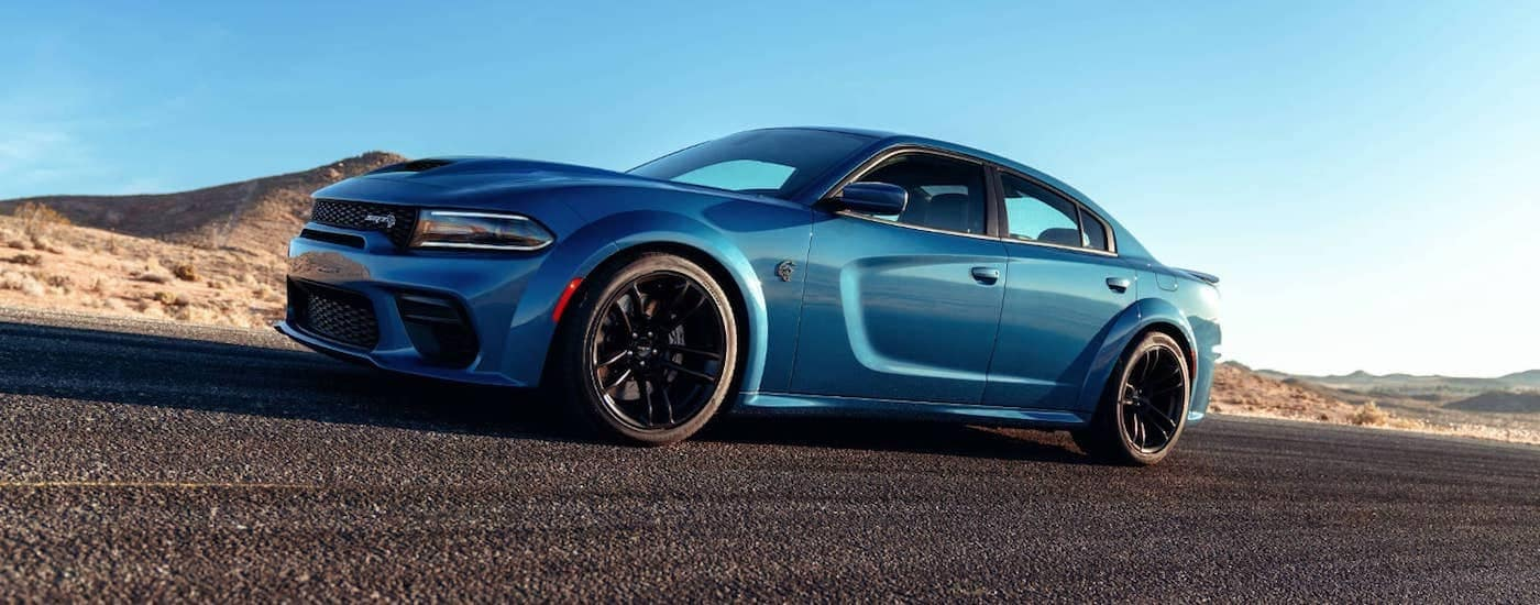 A blue 2021 Dodge Charger shown from a low angle parked on the pavement.