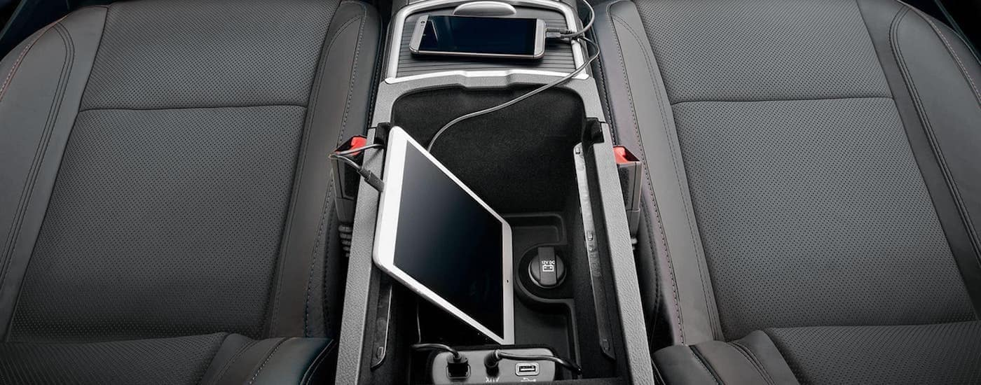 The center console with a phone and tablet charging is shown in a 2021 Dodge Charger.