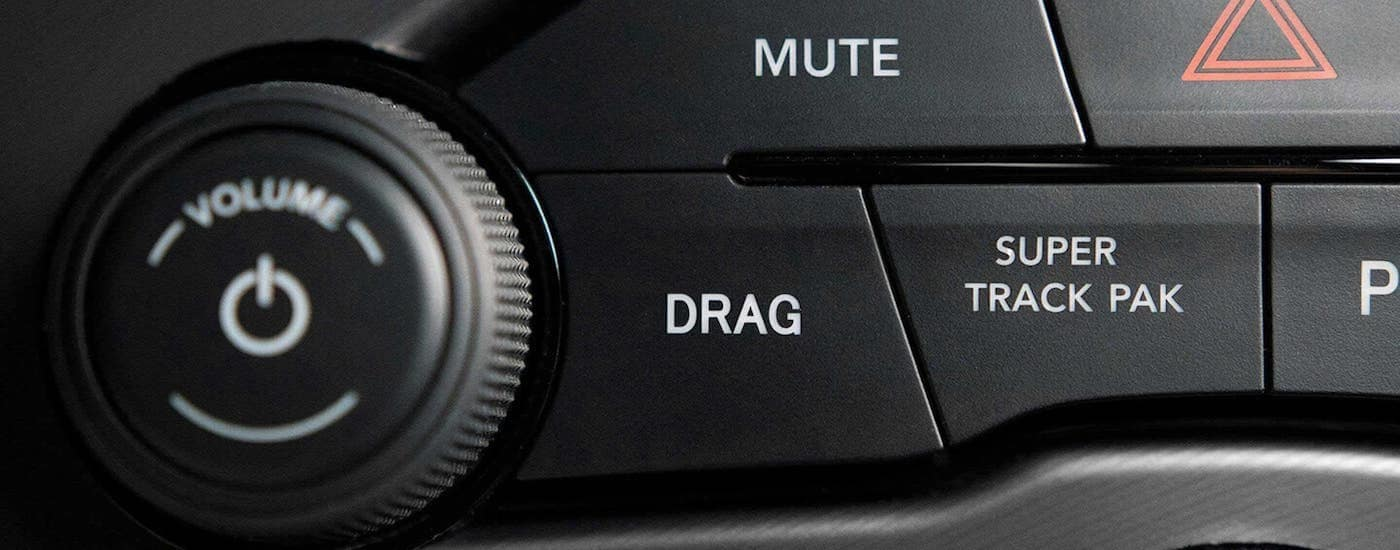 A close up shows the drag and track controls on a 2021 Dodge Challenger.