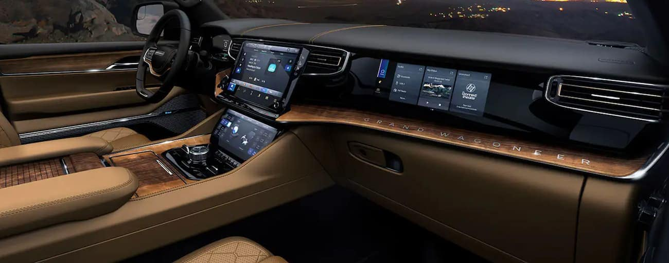 The black and tan interior of a 2022 Grand Wagoneer is shown.
