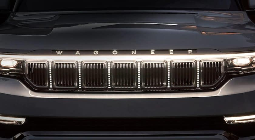 The grille of a grey 2022 Wagoneer is shown in closeup.