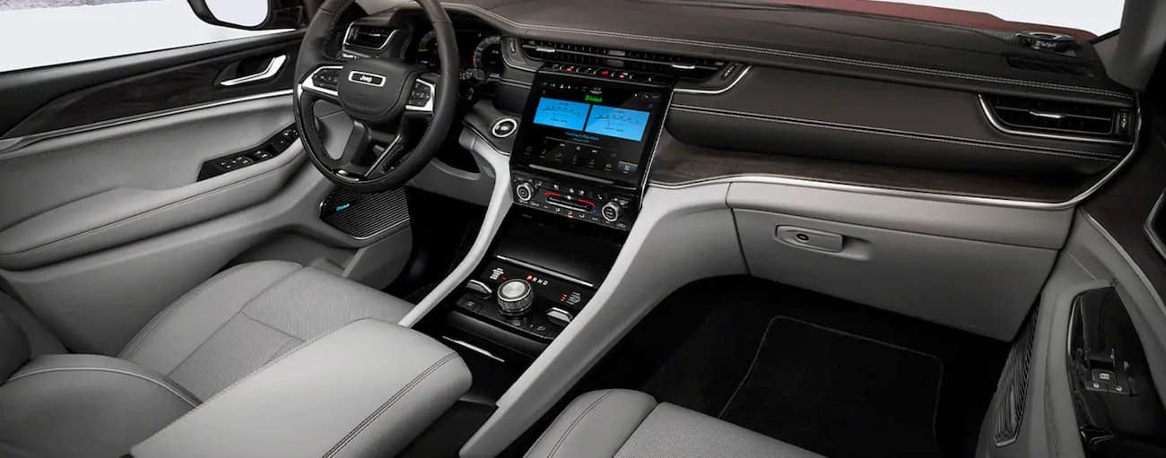The black and white interior is shown in a 2021 Jeep Grand Cherokee L.