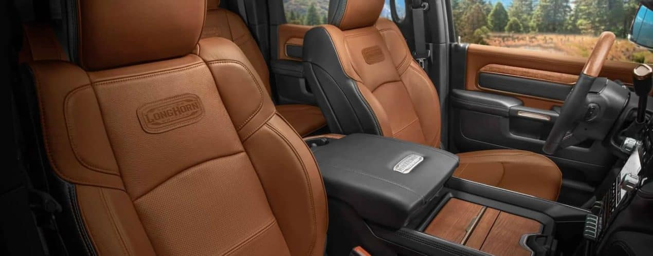 The brown and black front interior is shown in a 2021 Ram 2500 Limited Longhorn.