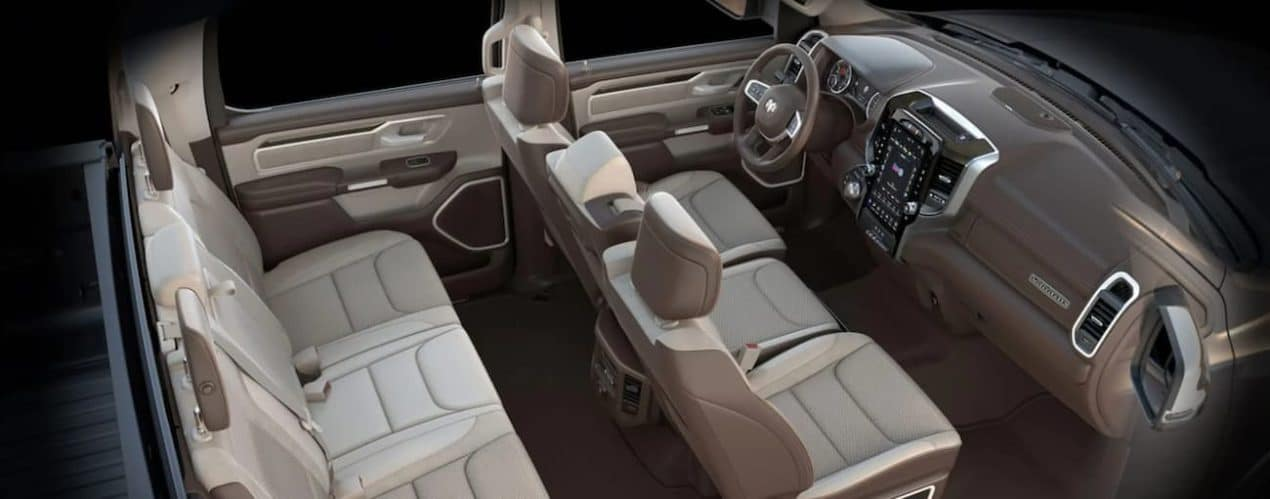 The tan interior of a 2021 Ram 1500 is shown.