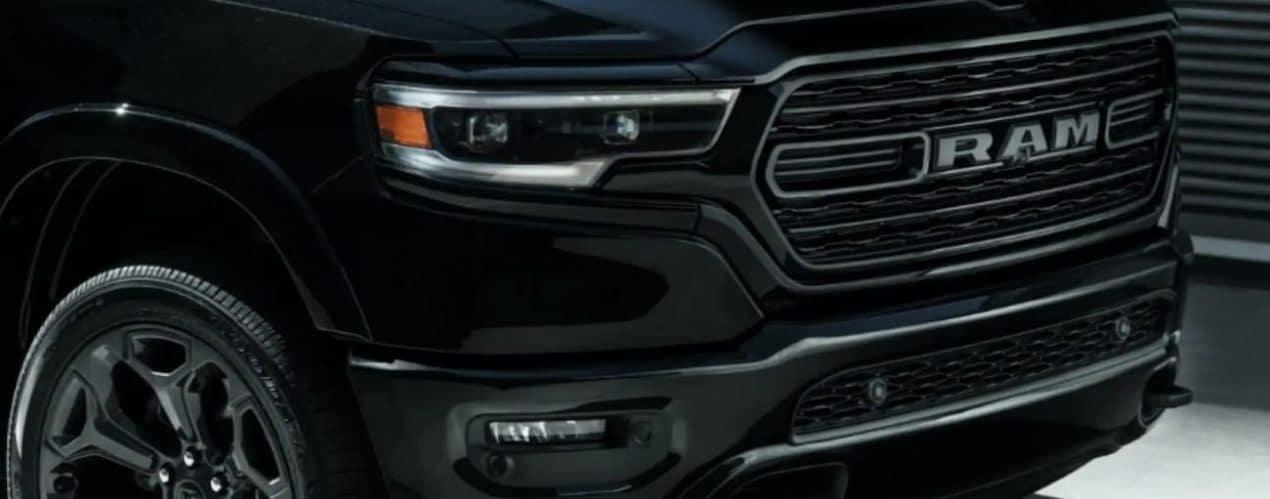 A close up of a 2021 Ram 1500 shows the passenger headlight.