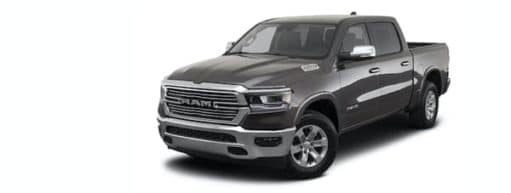 A grey 2021 Ram 1500 is angled left.