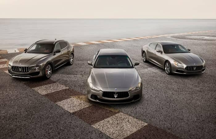 Maserati Models Parked by Lake