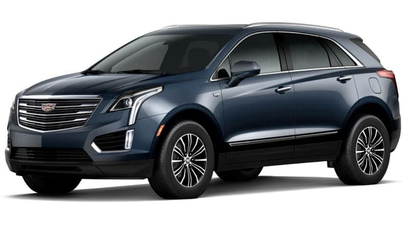 A blue 2019 Cadillac XT5 on white facing left