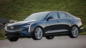 A black 2020 Cadillac CT4 facing left