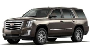 A brown 2020 Cadillac Escalade on white facing left