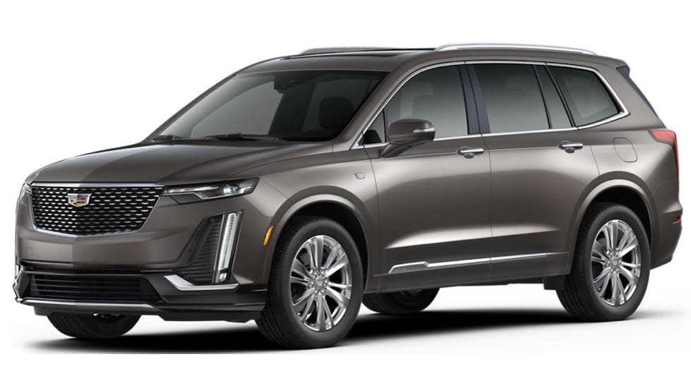 A brown 2020 Cadillac XT6 on white facing left