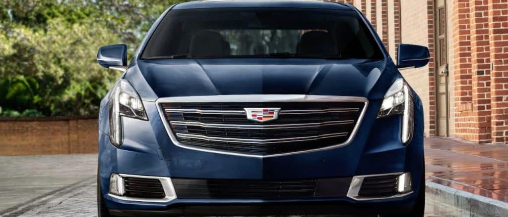 A blue Cadillac XTS from the front in Texas
