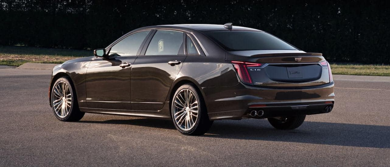A dark grey 2020 Cadillac CT6-V, which is a popular model among Cadillacs for sale, is in an open parking lot.