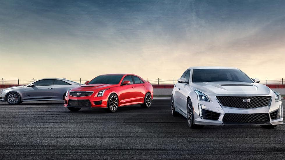 Gray, Red and White Cadillac CT4-Vs at a racetrack