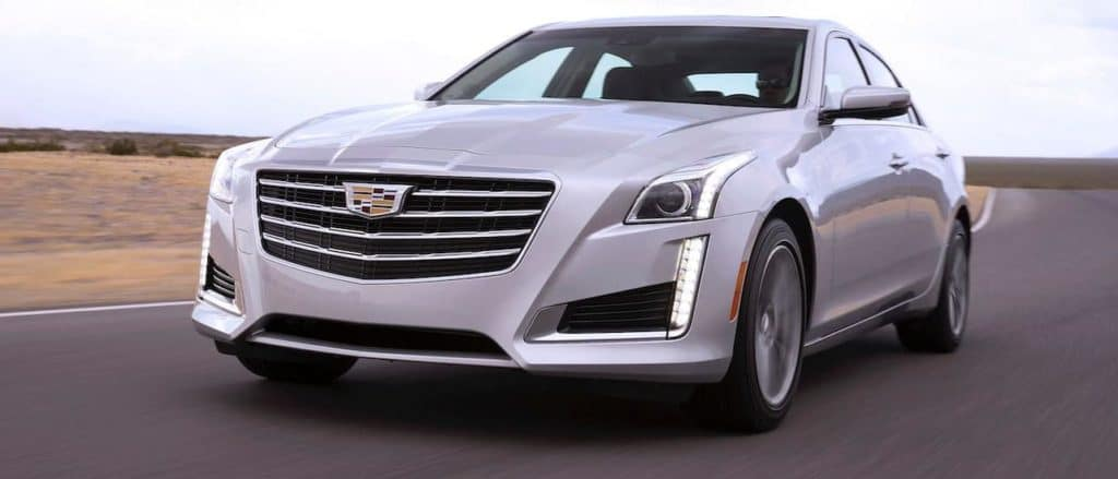 A silver 2017 Cadillac CTS is driving on a race track near Fort Worth, TX.