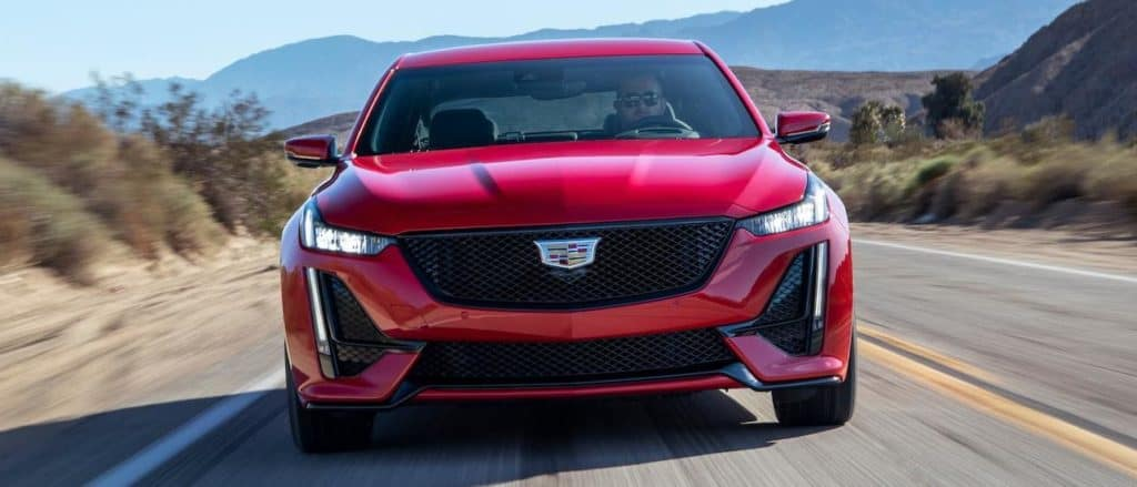 A red 2020 Cadillac CT5-V from the front driving on a desert highway from a Cadillac Dealer Near Me in Fort Worth, TX.