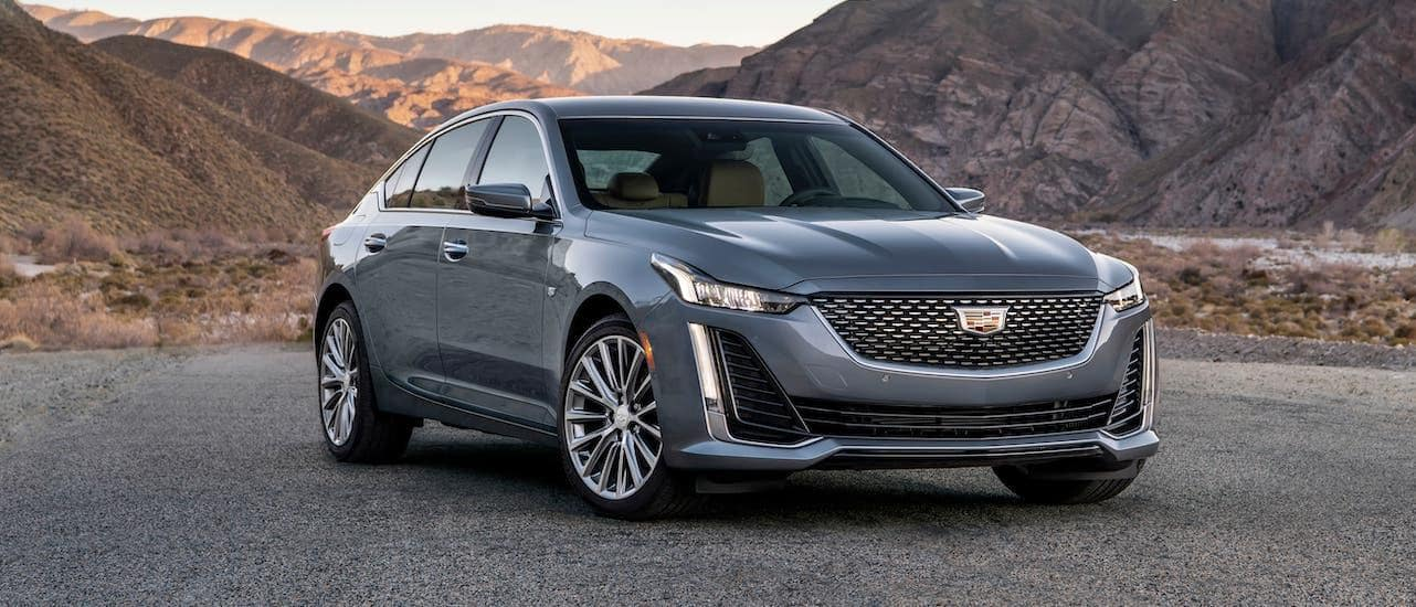 A gray 2020 Cadillac CT5 from a Cadillac Dealer Near Me in front of mountains.
