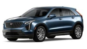 A blue 2020 Cadillac XT4 is facing left.