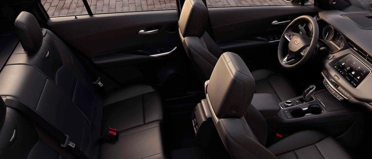 The black interior seats are shown inside a 2020 Cadillac XT4, winner of the 2020 Cadillac XT4 vs 2020 Volvo XC40 comparison, from a high angle.