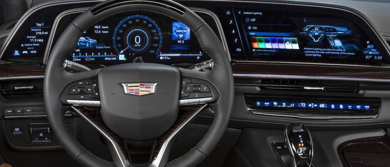 The extremely large dashboard and infotainment screen is shown in a 2021 Cadillac Escalade, the clear winner of 2021 Cadillac Escalade vs 2020 Cadillac Escalade Fort Worth TX.