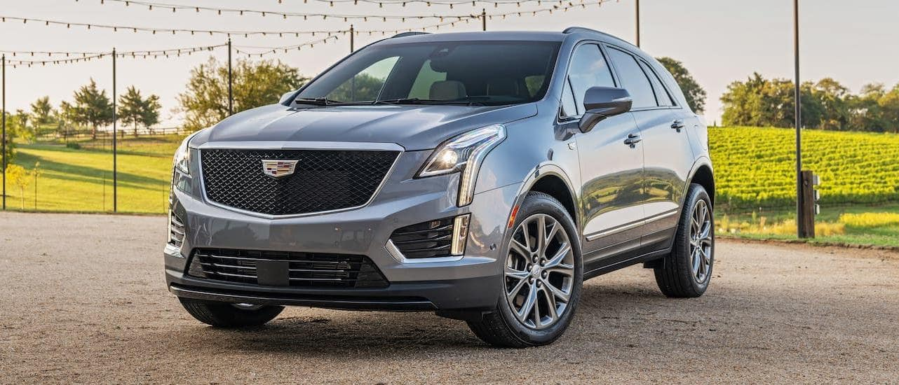 A gray 2020 Cadillac XT5 is parked in front of a winery near Fort Worth, TX.