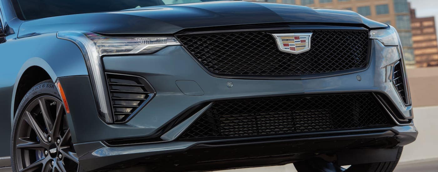 A closeup is shown of a gray 2020 Cadillac CT4-V grille from a Cadillac dealer near me, which is in a parking lot in Fort Worth, TX.