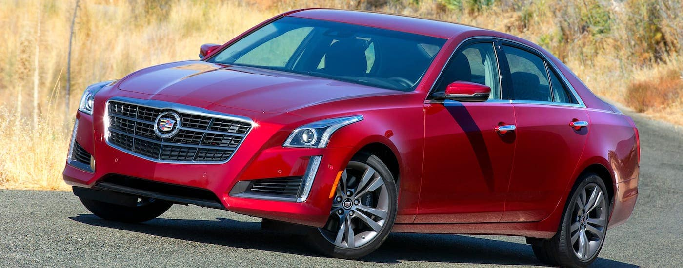 A used red 2015 Cadillac CTS VSport is parked on a road outside Fort Worth, TX.