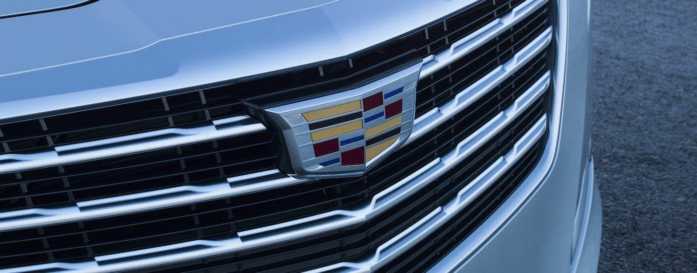 A closeup of the grille and emblem on a white used Cadillac 2017 CTS.