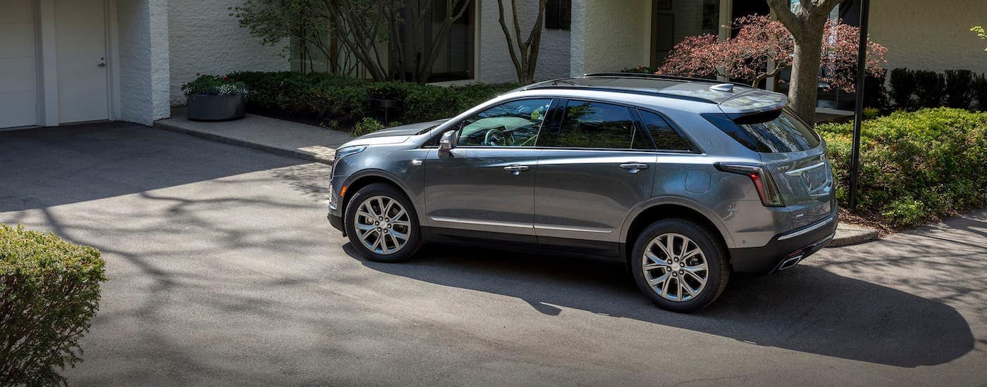 A gray 2020 Cadillac XT5 is parked in a driveway in Fort Worth, TX.