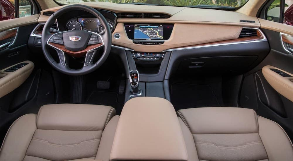 The tan interior of a 2017 Cadillac XT5 is shown.
