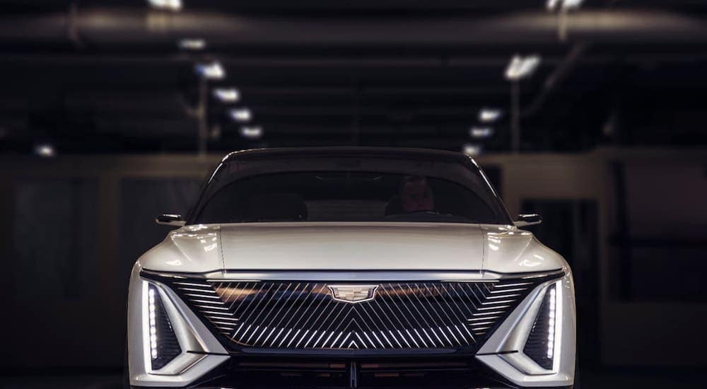A silver Cadillac Lyriq is shown from the front in a hangar near Fort Worth, TX.