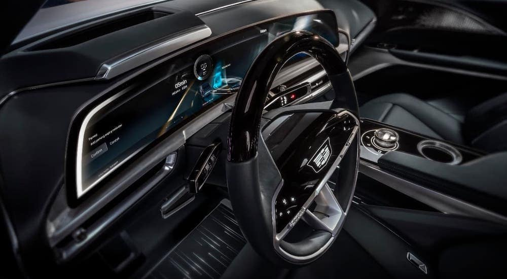 A closeup shows the futuristic steering wheel and information cluster on a Cadillac Lyriq, which may be coming to a Cadillac dealer near you.