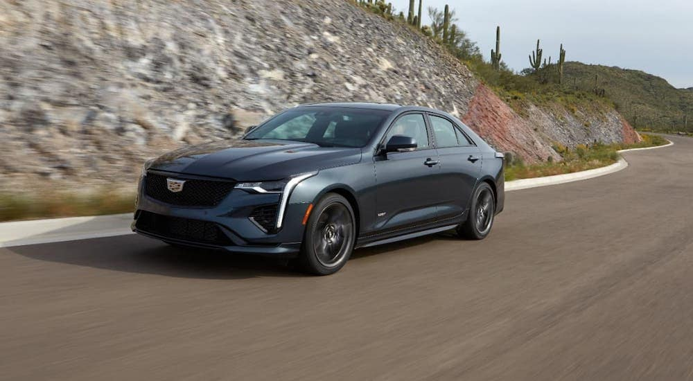 A black 2020 Cadillac CT4-V is driving on a highway near Fort Worth, TX.
