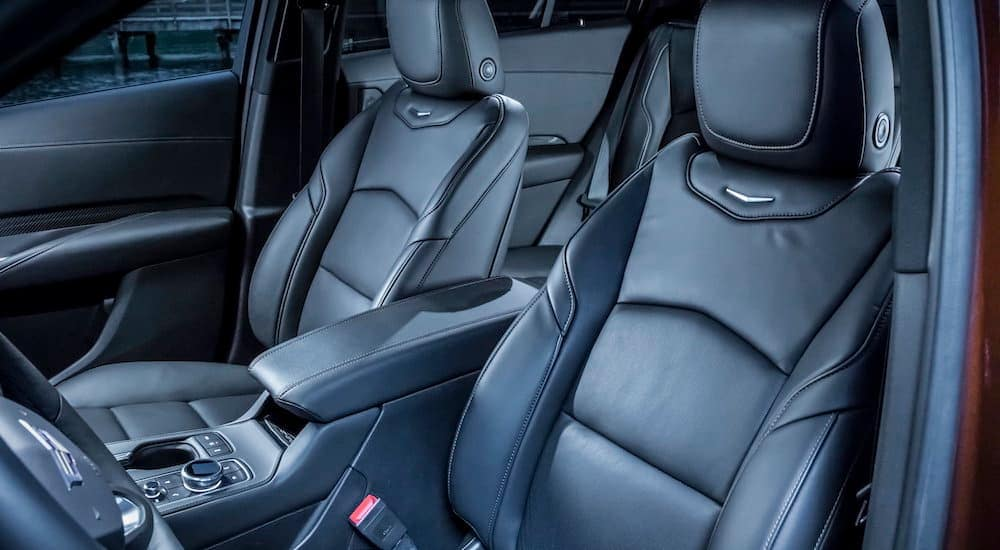 The black leather interior is shown on the 2019 used Cadillac XT4.