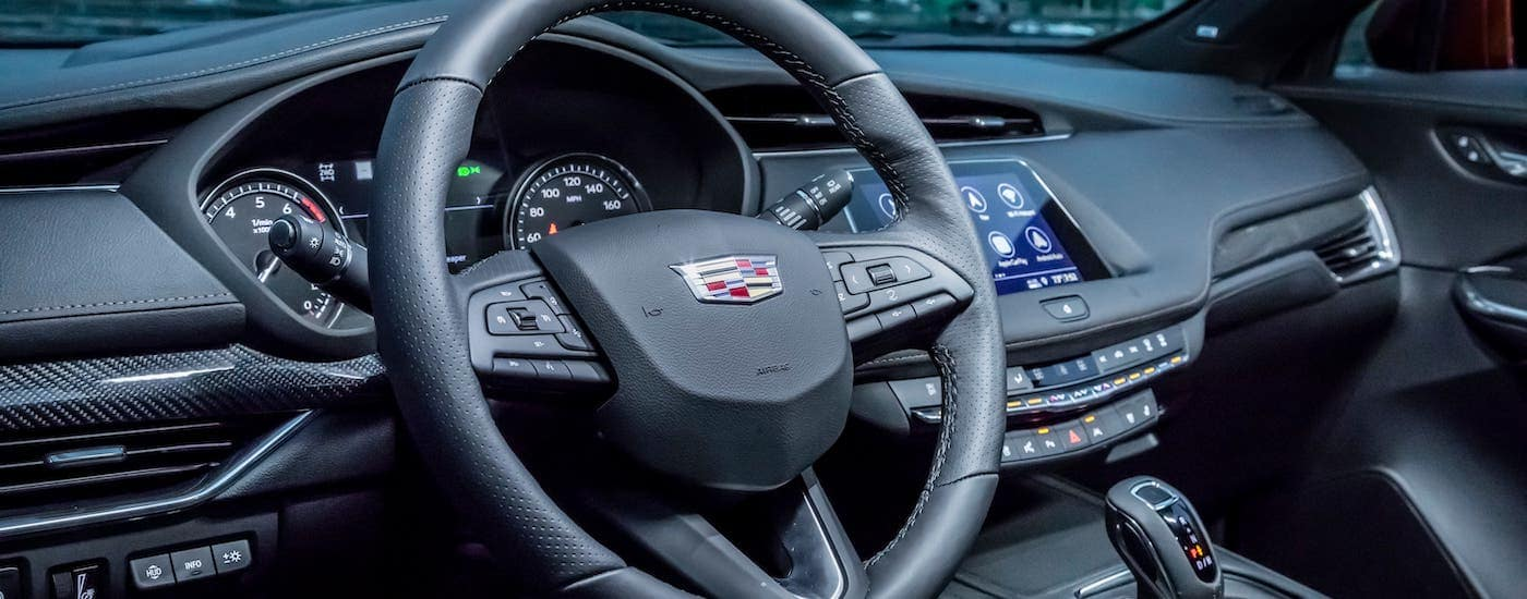 The steering wheel and interior of a 2019 Cadillac XT4 is shown.