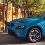 Blue 2022 Hyundai Kona Plugged in to a charging port