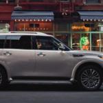 A 2021 INFINITI QX80 parked on a city street