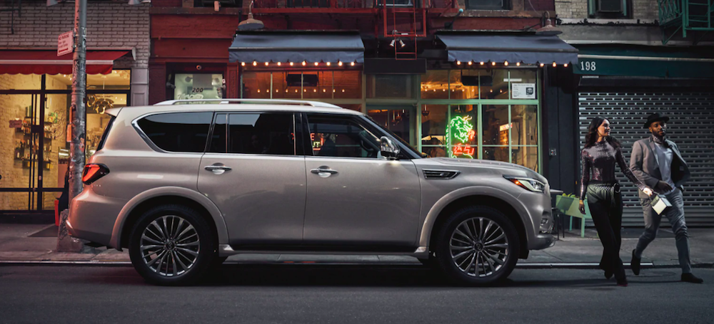 A 2021 INFINITI QX80 parked on a city street