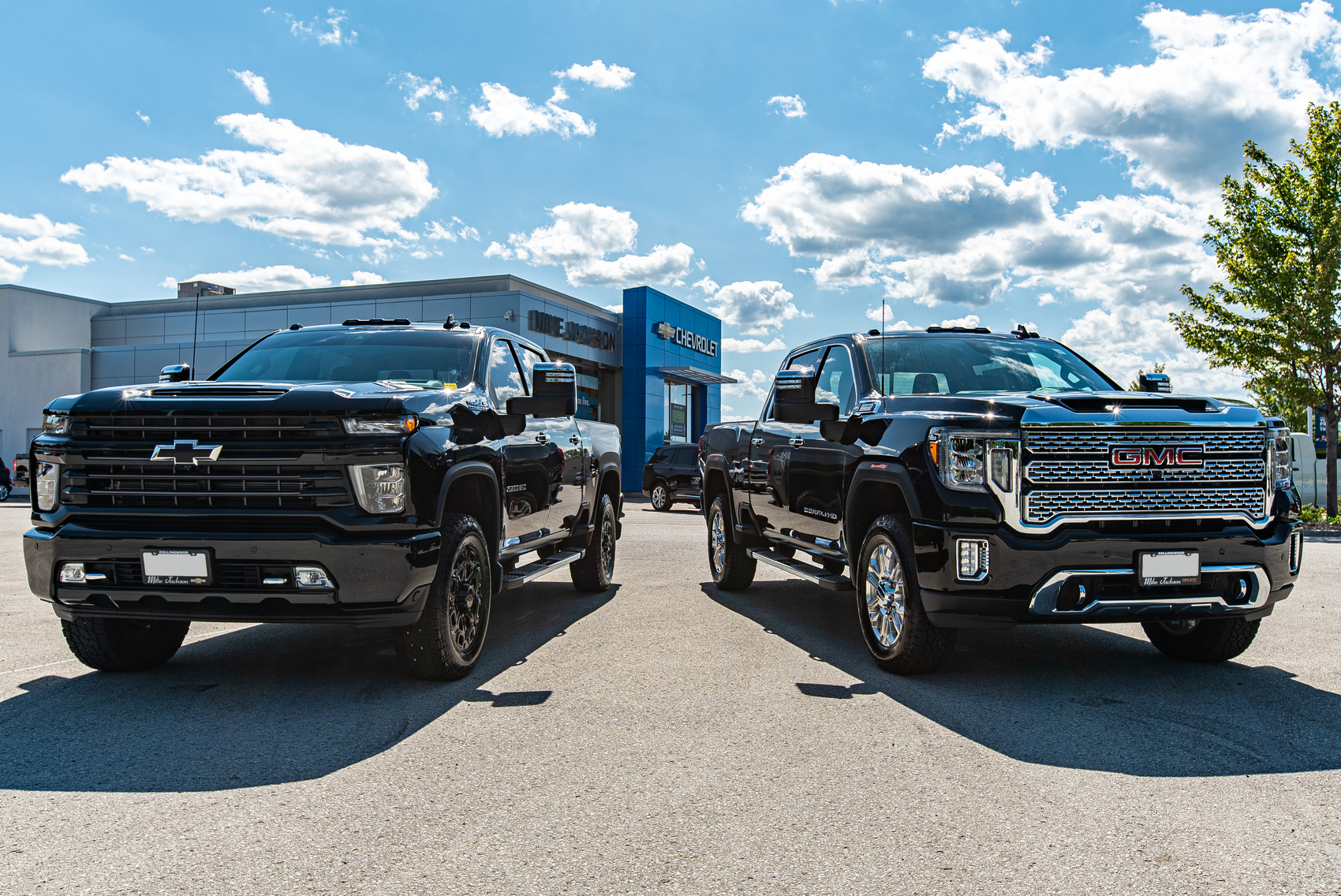 2020 GMC and Chevy Truck in front of Mike Jackson