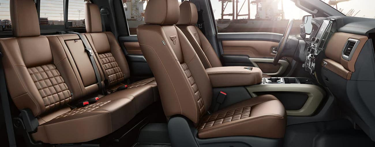 The brown interior of a 2021 Nissan Titan is shown from the side.