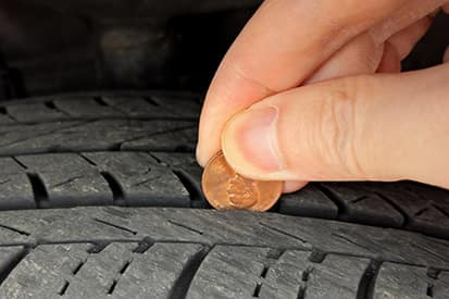 use a penny to measure tire tread depth